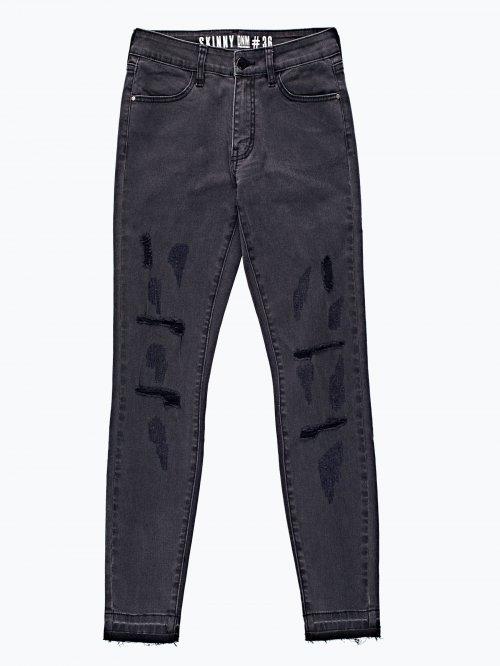Damaged skinny jeans in black wash
