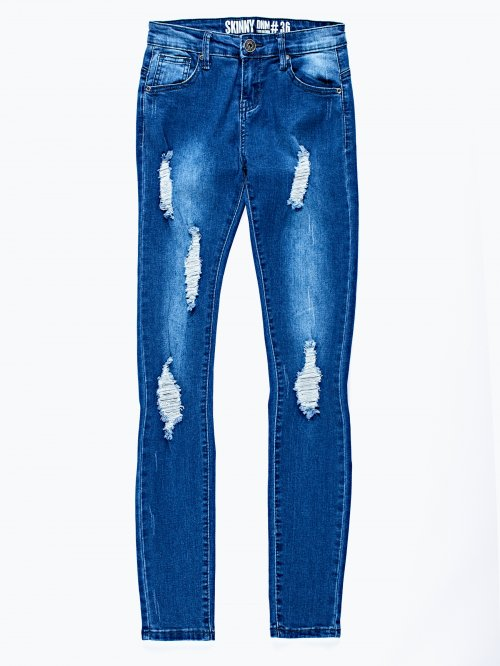 Distressed skinny jeans in mid blue wash