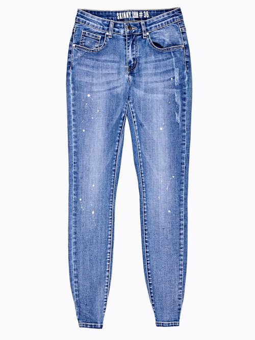 Distressed skinny jeans in blue wash
