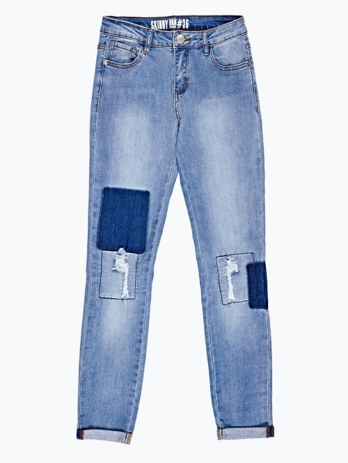 Damaged skinny jeans in mid blue wash