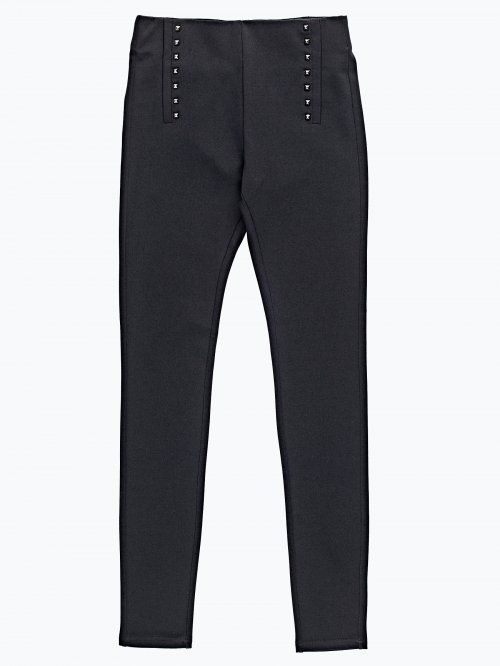 Knit trousers with rivets