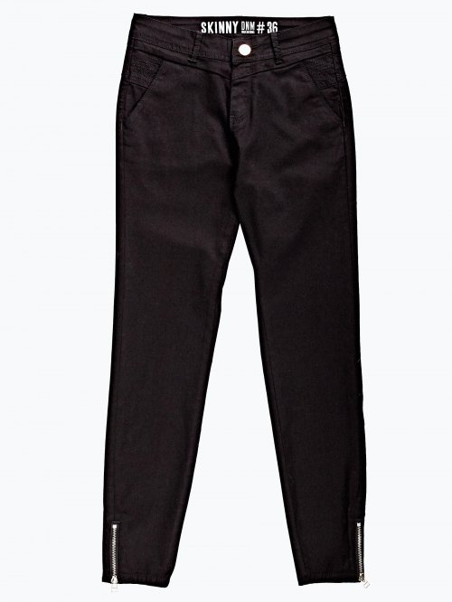 Damaged jeans with zipper details