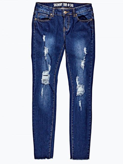 Damaged skinny jeans in dark blue wash