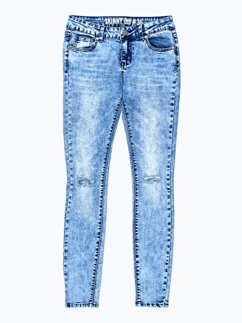 Ripped knees skinny jeans in blue wash