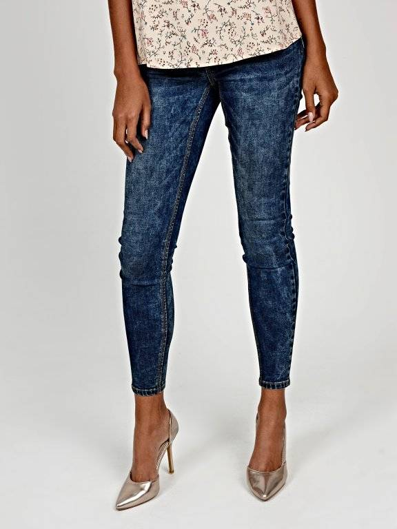 Skinny jeans in mid blue wash