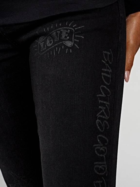 Damaged skinny jeans with message prints
