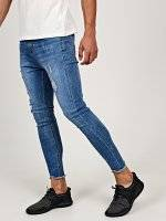 Damaged carrot cropped fit jeans with frayed hem