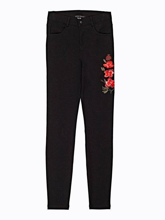 Skinny trousers with floral embroidery