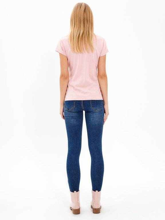 SKINNY JEANS WITH DECORATIVE METAL RINGS