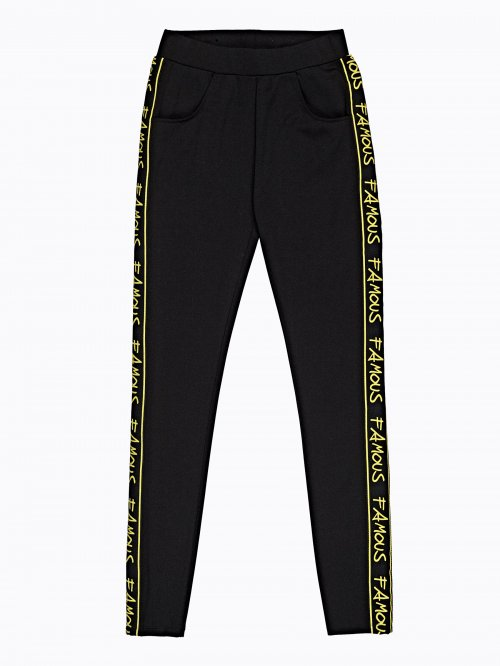 Stretch slim trousers with decorative tape