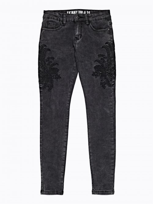 Embroidered skinny jeans in black wash