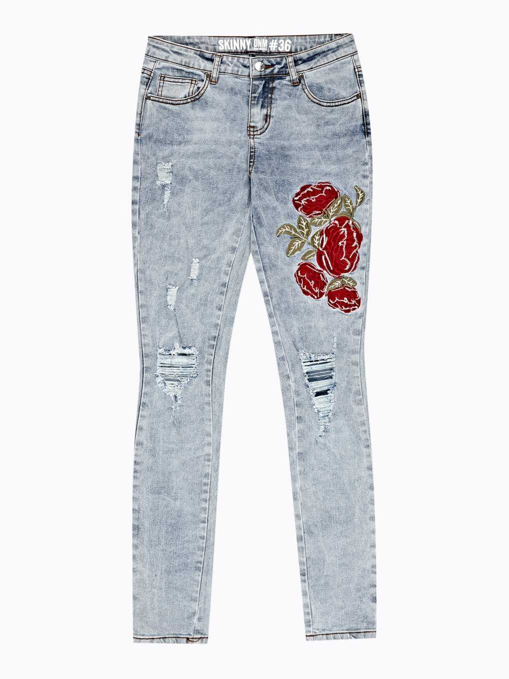 Damaged skinny jeans with floral embroidery