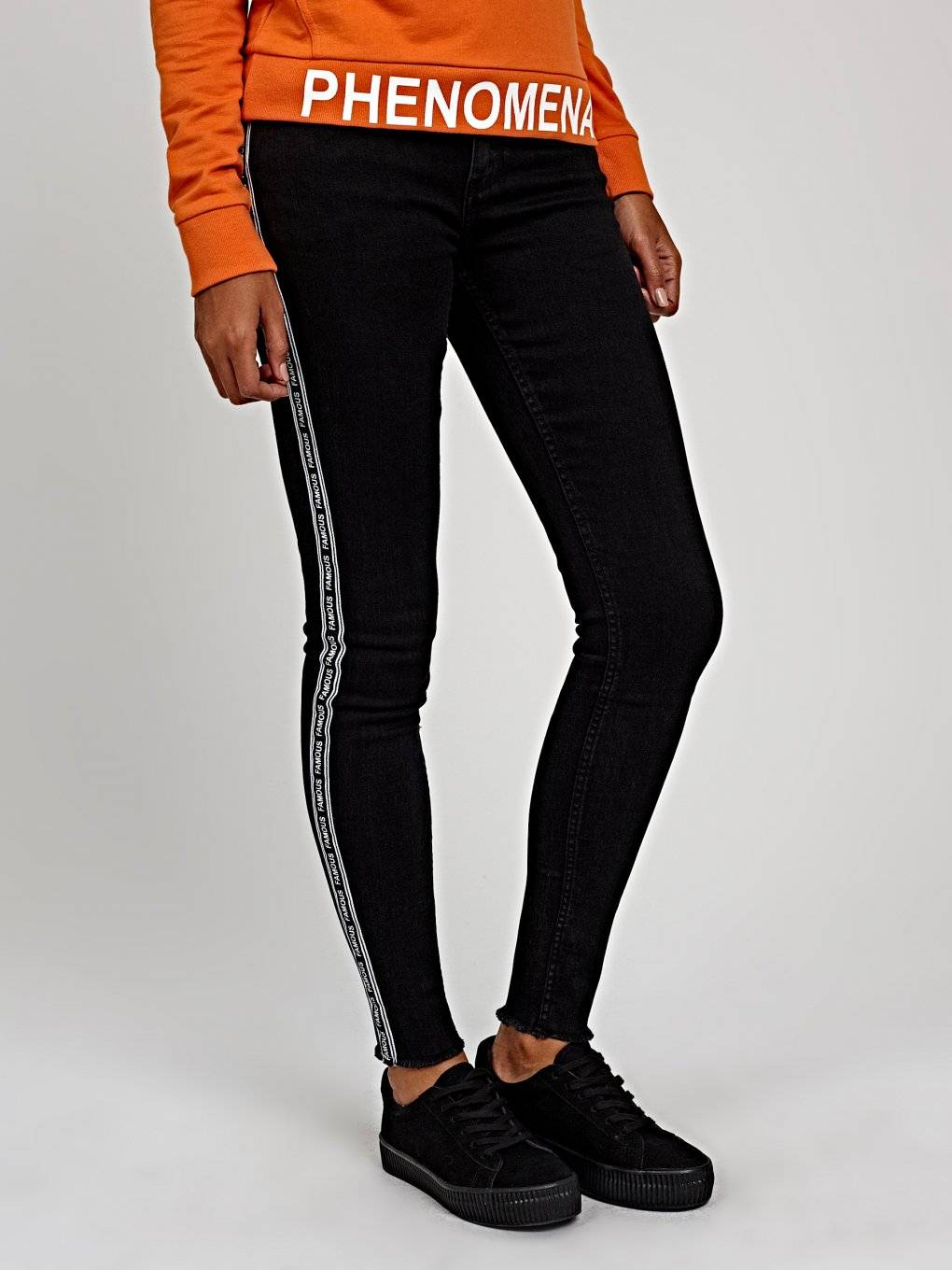 Skinny jeans with printed side tape