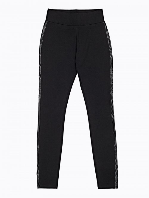 Knitted slim trousers with faux leather side stripe