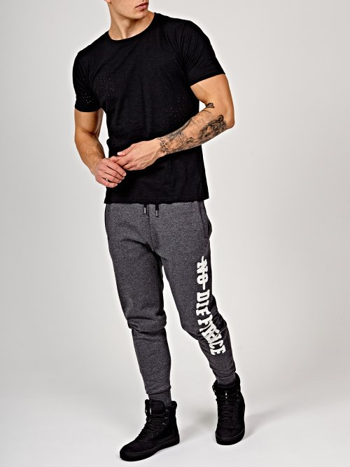 Sweatpants with chenille patch