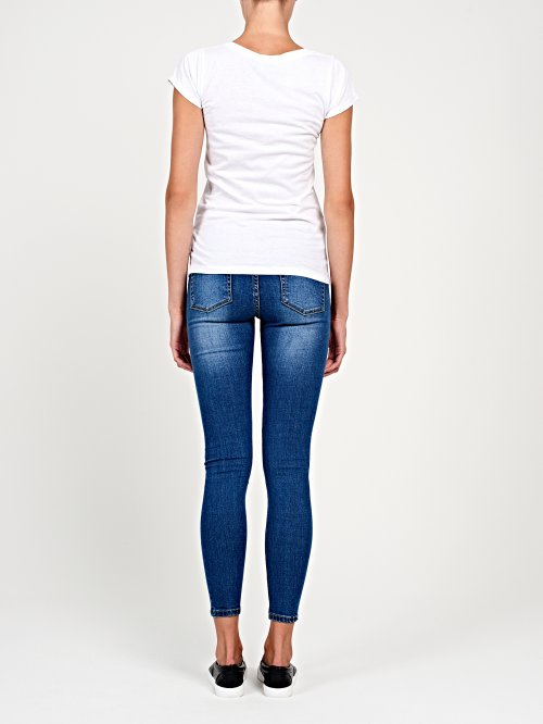 Ripped knees skinny jeans in mid blue wash