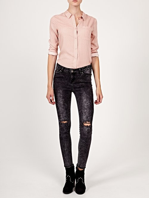 Damaged skinny jeans with splatter details