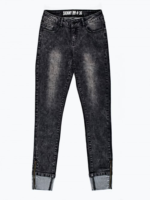 Skinny jeans with ankle zippers in black snow wash