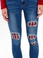 DAMAGED PLAID LINED SKINNY JEANS