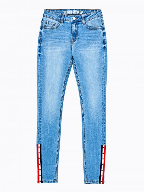Skinny jeans with decorative tape on hem
