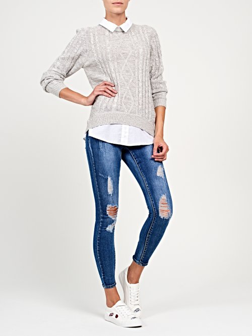 Ripped skinny jeans in mid blue wash