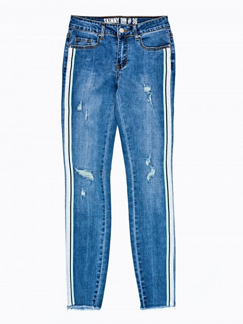 Taped skinny distressed jeans in mid blue wash