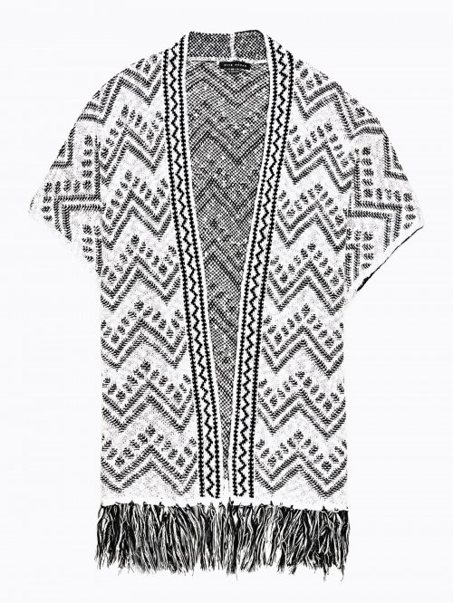 Jacquard poncho with fringes