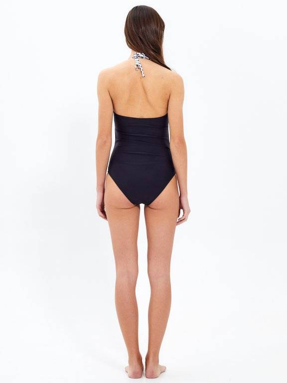 Swimsuit with polka dot bra part