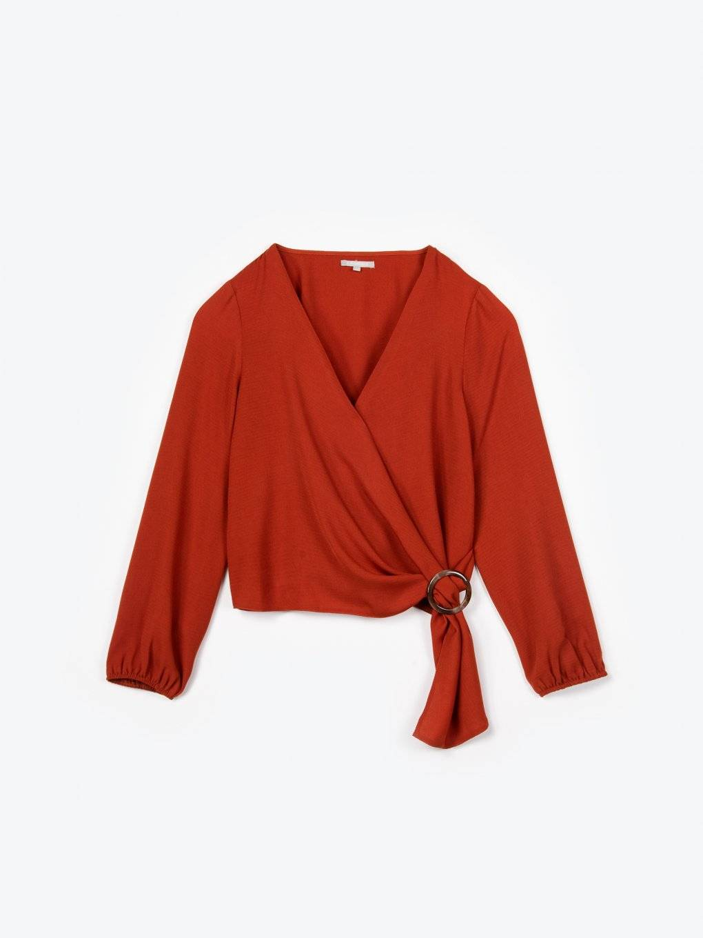 Wrap blouse with round buckle