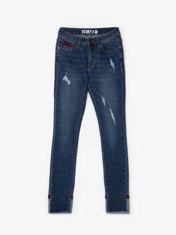 Taped distressed skinny jeans