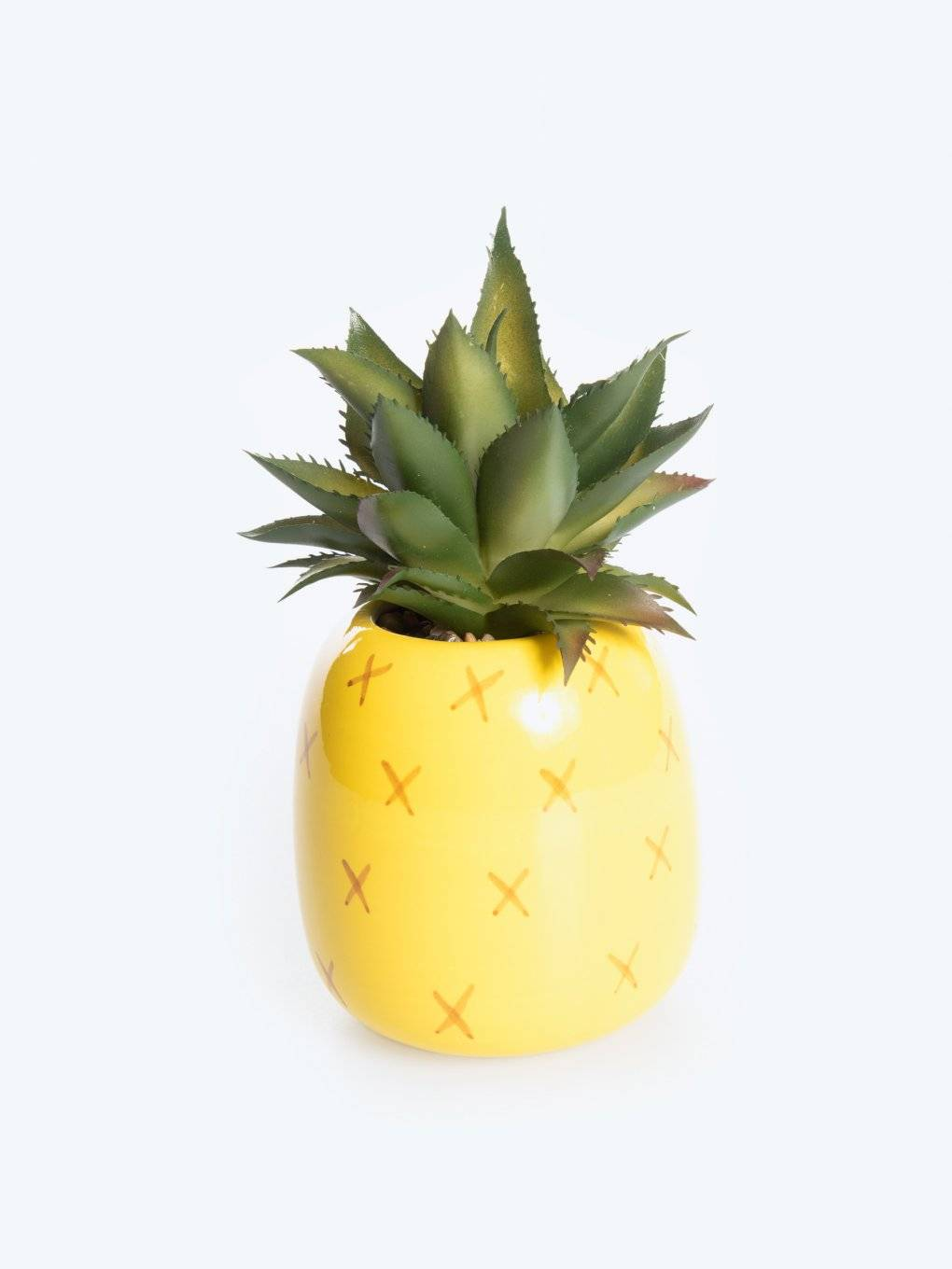 Pineapple pot with faux flower